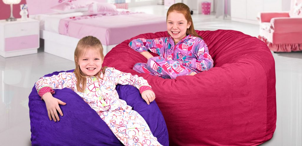 Two girls on two bean bag chairs for kids