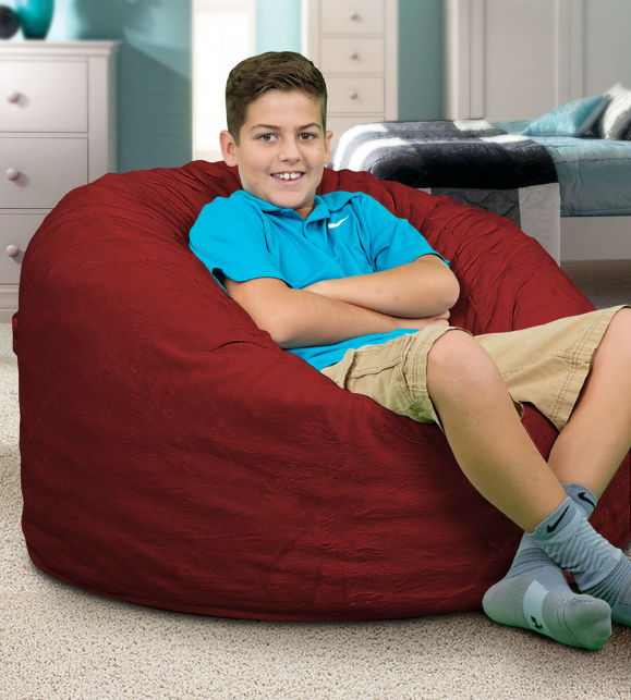 Kid chilling on a giant bean bag